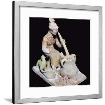 Greek terracotta statuette of a woman cooking. Artist: Unknown-Unknown-Framed Giclee Print