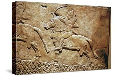 Relief of an Assyrian archer on horseback. Artist: Unknown-Unknown-Stretched Canvas Print