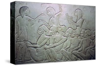 Detail of an Egyptian stele showing an overseer, slaves and scribe. Artist: Unknown-Unknown-Stretched Canvas Print