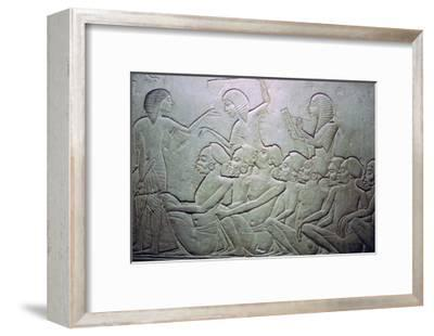 Detail of an Egyptian stele showing an overseer, slaves and scribe. Artist: Unknown-Unknown-Framed Giclee Print