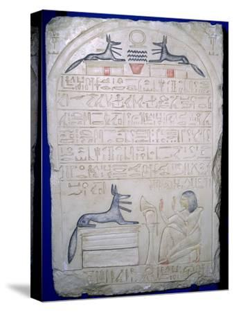 Egyptian elief stele of a man adoring Anubis. Artist: Unknown-Unknown-Stretched Canvas Print
