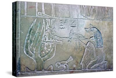 Egyptian relief showing a dead woman and Hathor. Artist: Unknown-Unknown-Stretched Canvas Print
