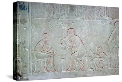 Egyptian relief showing vase painters, 14th century BC Artist: Unknown-Unknown-Stretched Canvas Print