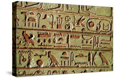 Egyptian hieroglyphs on a funerary stele. Artist: Unknown-Unknown-Stretched Canvas Print