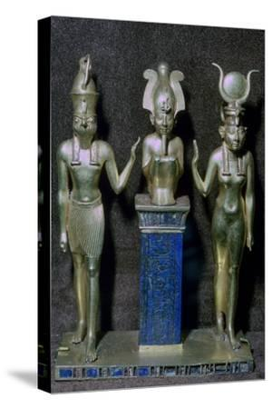 Egyptian gold statuettes of Osiris, Horus, and Isis. Artist: Unknown-Unknown-Stretched Canvas Print