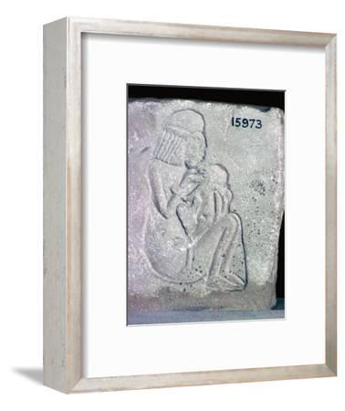Egyptian relief of a woman suckling a child, 14th century BC. Artist: Unknown-Unknown-Framed Giclee Print