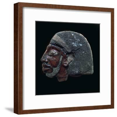 Egyptian glazed relief of a Nubian slave. Artist: Unknown-Unknown-Framed Giclee Print