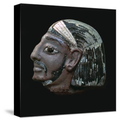 Egyptian glazed relief of a Hittite slave. Artist: Unknown-Unknown-Stretched Canvas Print
