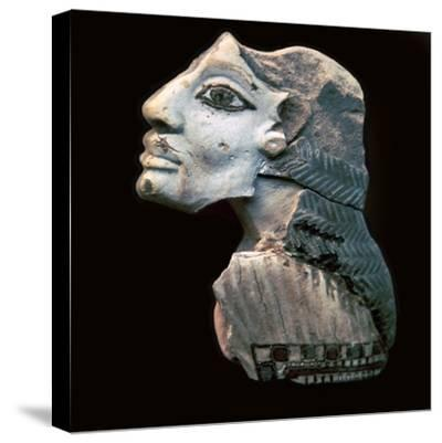 Egyptian glazed relief of a Lybian captive. Artist: Unknown-Unknown-Stretched Canvas Print