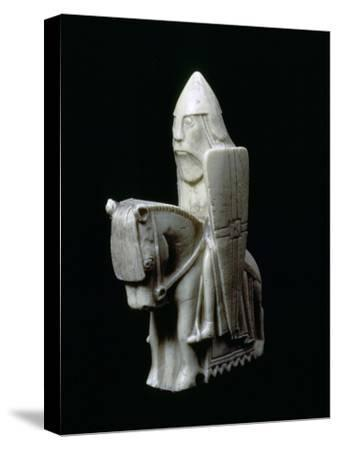 A Knight - The Lewis Chessmen, (Norwegian?), c1150-c1200. Artist: Unknown-Unknown-Stretched Canvas Print