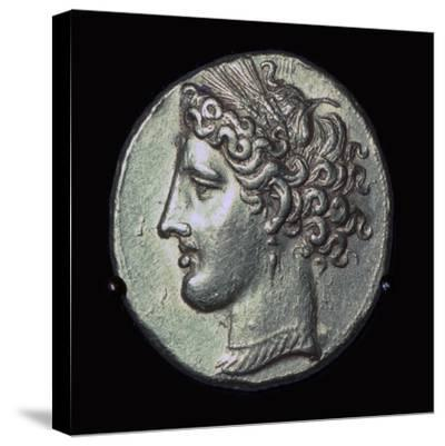 Head of Tanit on a gold tridrachm. Artist: Unknown-Unknown-Stretched Canvas Print