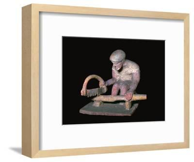 Greek terracotta figure of a man sawing wood, 6th century BC. Artist: Unknown-Unknown-Framed Giclee Print