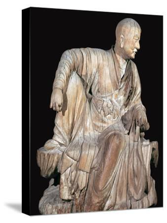 Statuette of a disciple of the Buddha, 14th century. Artist: Unknown-Unknown-Stretched Canvas Print