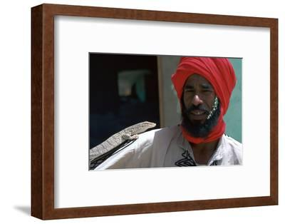 Keeper with a lizard in Tozeur zoo in Tunisia. Artist: Unknown-Unknown-Framed Photographic Print