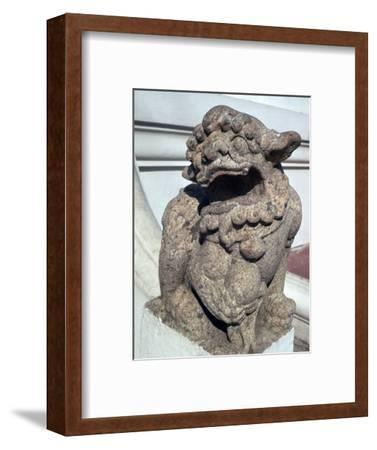 Lion guardian on the steps of a Buddhist temple. Artist: Unknown-Unknown-Framed Giclee Print