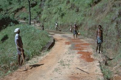Primitive road-repairs in Sri Lanka. Artist: CM Dixon Artist: Unknown-CM Dixon-Framed Photographic Print
