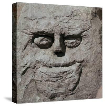 Stone head from a pagan Celtic shrine. Artist: Unknown-Unknown-Stretched Canvas Print