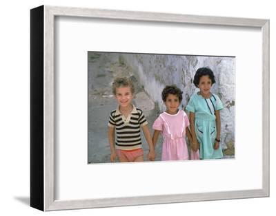 Three children in Kairouan, Tunisia. Artist: Unknown-Unknown-Framed Photographic Print