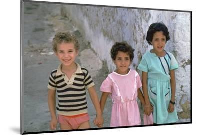 Three children in Kairouan, Tunisia. Artist: Unknown-Unknown-Mounted Photographic Print