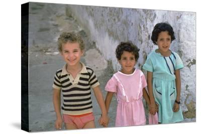 Three children in Kairouan, Tunisia. Artist: Unknown-Unknown-Stretched Canvas Print
