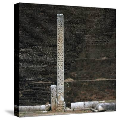 A stele in front of the Dakhina Stupa, 2nd century. Artist: Unknown-Unknown-Stretched Canvas Print