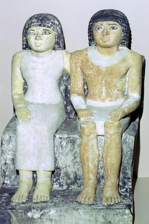 Limestone Egyptian statue of a man and his wife. Artist: Unknown-Unknown-Framed Giclee Print