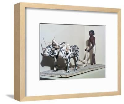 Wooden model of a man ploughing with oxen, from Egypt, Middle Kingdom, c2040-1750 BC-Unknown-Framed Giclee Print