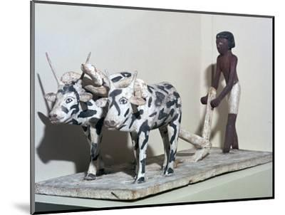 Wooden model of a man ploughing with oxen, from Egypt, Middle Kingdom, c2040-1750 BC-Unknown-Mounted Giclee Print