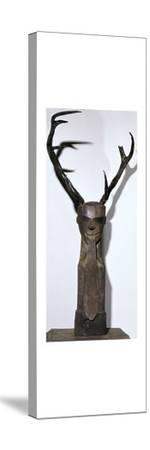 Chinese wooden sculpture of an antlered head-Unknown-Stretched Canvas Print