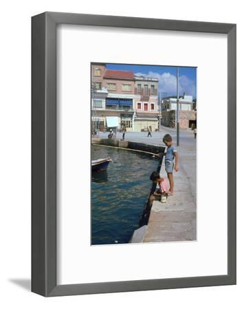 Children fishing in the harbour of Khania-Unknown-Framed Photographic Print