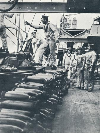 Receiving shells for the naval guns on the deck of a battleship, c1914-Unknown-Framed Photographic Print
