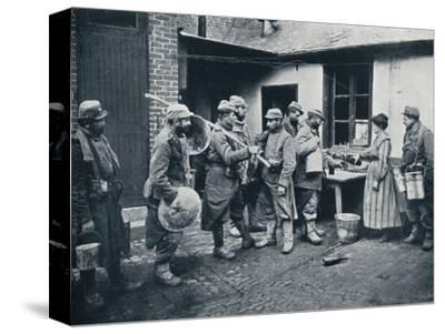 French soldiers returning from the trenches make a halt for refreshment, c1914-Unknown-Stretched Canvas Print