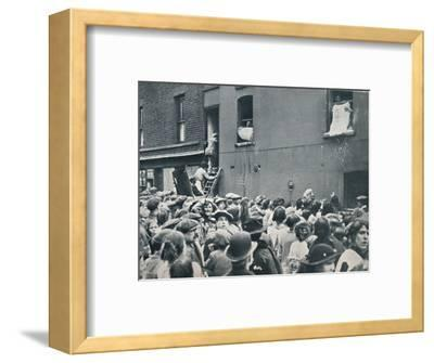 Crowd watching the looting of a German house in Poplar, c1914-Unknown-Framed Photographic Print