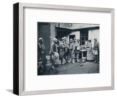 French soldiers returning from the trenches make a halt for refreshment, c1914-Unknown-Framed Photographic Print