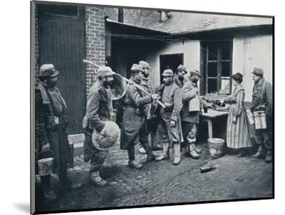 French soldiers returning from the trenches make a halt for refreshment, c1914-Unknown-Mounted Photographic Print