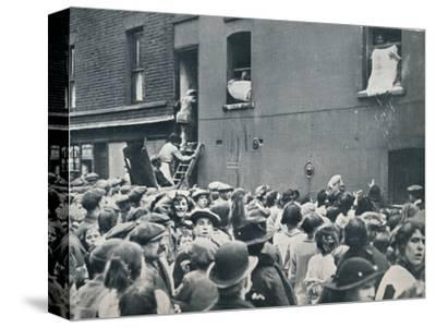 Crowd watching the looting of a German house in Poplar, c1914-Unknown-Stretched Canvas Print