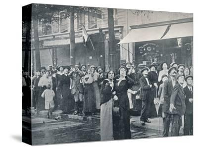 Paris crowd watching one of the German aeroplanes flying over the city, c1914-Unknown-Stretched Canvas Print