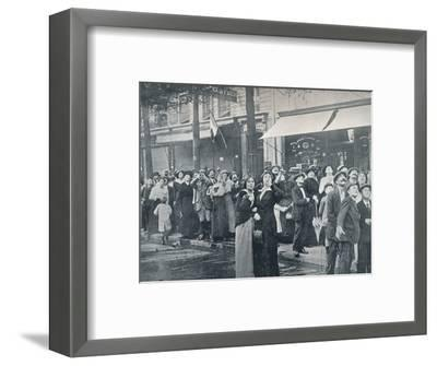 Paris crowd watching one of the German aeroplanes flying over the city, c1914-Unknown-Framed Photographic Print