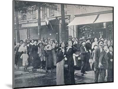 Paris crowd watching one of the German aeroplanes flying over the city, c1914-Unknown-Mounted Photographic Print
