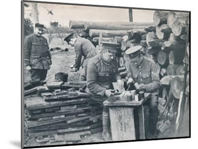 British engineers with the Expeditionary Force making hand grenades out of tobacco tins, c1914-Unknown-Mounted Photographic Print