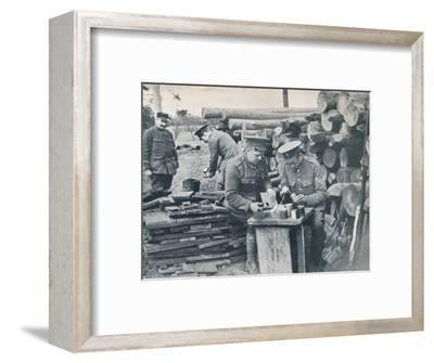 British engineers with the Expeditionary Force making hand grenades out of tobacco tins, c1914-Unknown-Framed Photographic Print