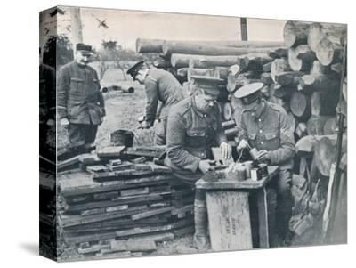 British engineers with the Expeditionary Force making hand grenades out of tobacco tins, c1914-Unknown-Stretched Canvas Print
