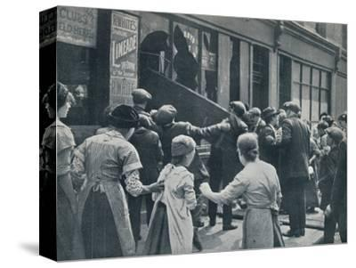 Anti-German rioting in London: A crowd breaking in the windows of a German shop', c1914-Unknown-Stretched Canvas Print