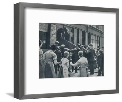 Anti-German rioting in London: A crowd breaking in the windows of a German shop', c1914-Unknown-Framed Photographic Print