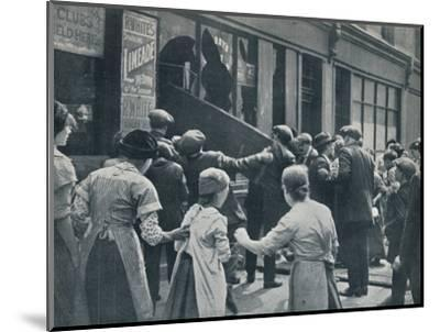 Anti-German rioting in London: A crowd breaking in the windows of a German shop', c1914-Unknown-Mounted Photographic Print