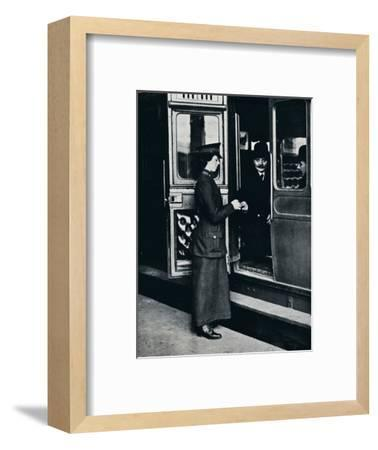 A woman ticket inspector at work, c1914-Unknown-Framed Photographic Print
