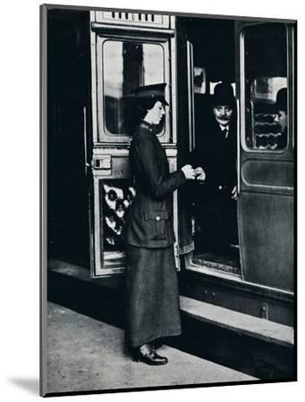 A woman ticket inspector at work, c1914-Unknown-Mounted Photographic Print