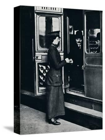 A woman ticket inspector at work, c1914-Unknown-Stretched Canvas Print