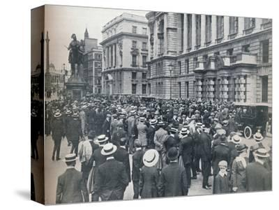 Crowd waiting outside the War Office on the morning before war was declared', 1914-Unknown-Stretched Canvas Print