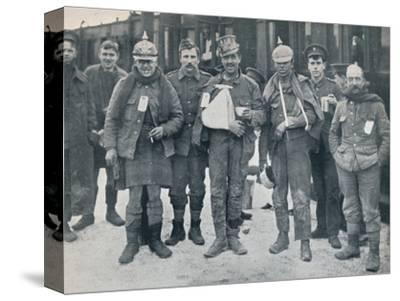 Some cheerful wounded from the Neuve Chapelle fighting, wearing captured German helmets, 1915-Unknown-Stretched Canvas Print
